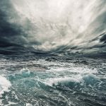 Dramatic stormy dark cloudy sky over sea natural photo background